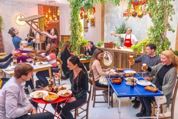 Diners are setting up their tables at the Trattoria Birra Moretti, the world's first BYOT (bring your own table) restaurant